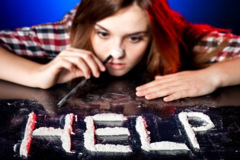 A young cocaine snob, with whom the word HELP has been formed (help in English)
