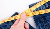 Cinta métrica midiendo la obesidad