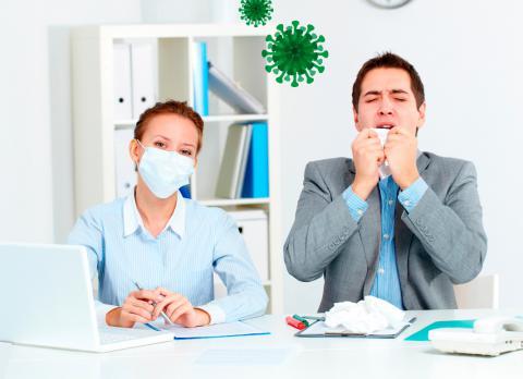 personas trabajando en una oficina con síntomas de coronavirus